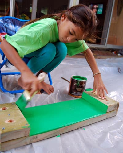 painting the bench with Valspar