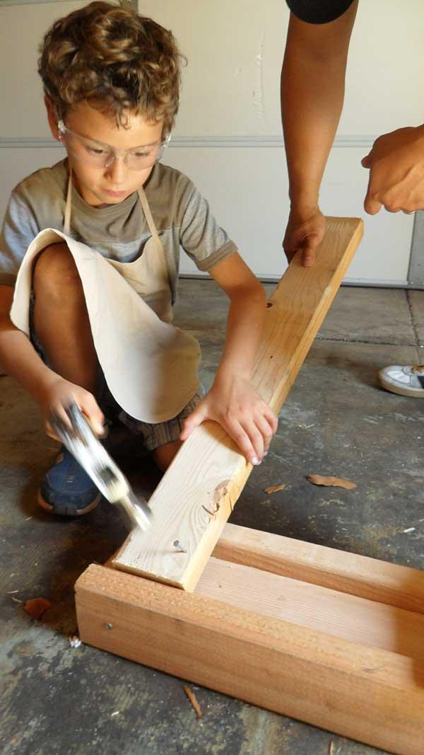 boy-using-hammer